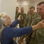 Soldiers Wait In Line For the Hug Lady