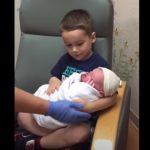 Newborn In his Brother's Lap
