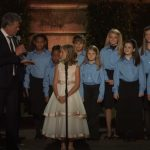 The young girl in the center begins to sing