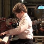 Accompanied by His Teddy bear This kid came to play Beethoven