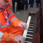 A traffic Marshall sits down at a public piano